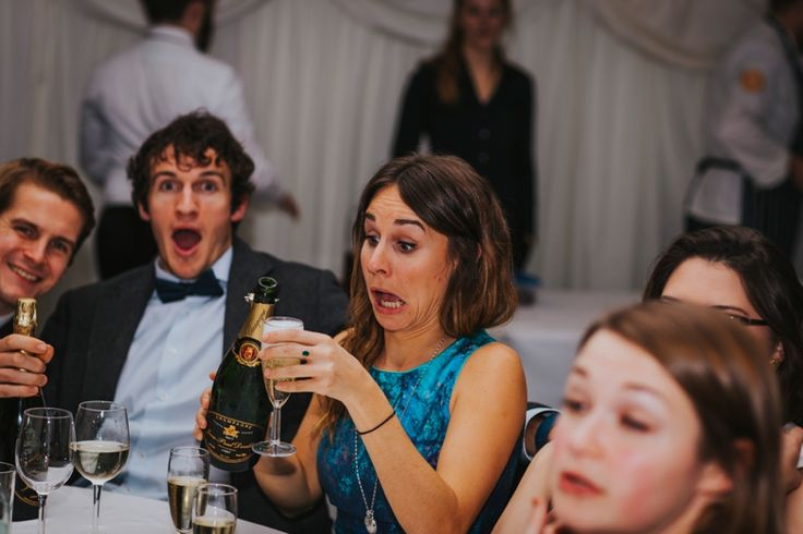 When you're not paying attention to how much bubbly you're pouring! Photo by Benjamin Stuart Photography #weddingphotography #bubbly #weddingfun #funface #facepulling #cheers #toast #speeches