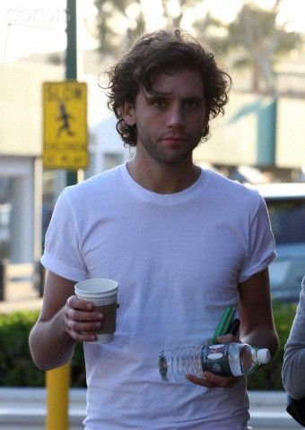 British singer Mika enjoys a tea with a female friend (his sister) in Cross Creek, Malibu. Mika seems to like the colour green with matching watch and wallet/purse April 05, 2009