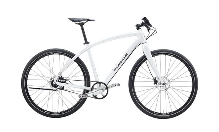 Porsche Bike S*. High performance frame made of 7005 hydroforming aluminum. Rigid forks made of carbon. Shimano 11-speed Alfine hub gear system. Low-wear geared belt drive. Hydraulic disc brakes [...