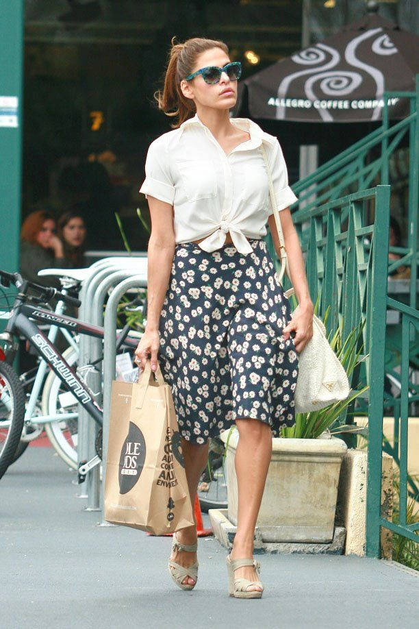 Eva Mendes makes normal-chic look easy as pie.  White Prada purse helps, too.