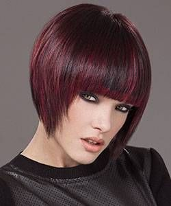 Dark Geometric bob hair cut with red violet highlights