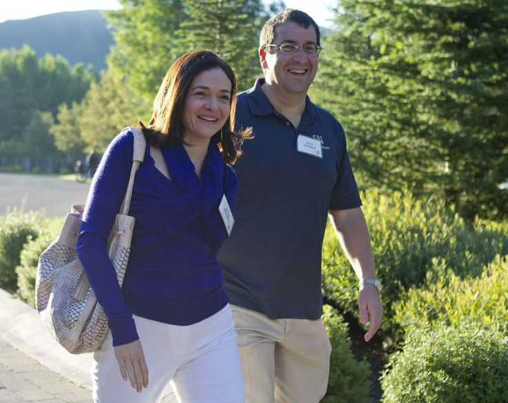 Facebook chief operating officer Sheryl Sandberg, left, and Dave Goldberg, CEO of Survey Monkey, arrive at the Sun Valley Inn for the 2011 Allen and Co. Sun Valley Conference, on July 6, 2011, in Sun Valley, Idaho.
