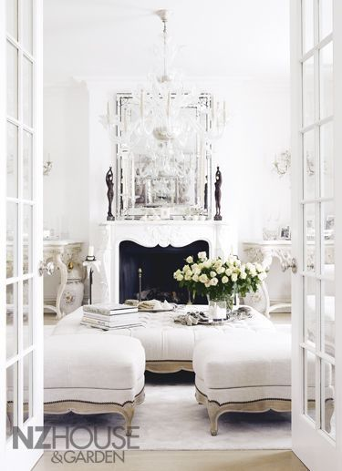 White chic french provincial antique living lounge room with french doors venetian mirror  ottoman