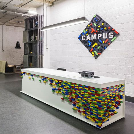 A reception desk decorated with multicoloured Duplo bricks at the new Google Campus