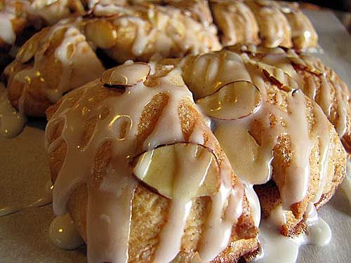 How to make Bear Claws:    1 recipe Grandmother Bread for Pastries, ready for use  3 tablespoons butter, melted  1/2 cup sugar  2 teaspoons cinnamon  additional melted butter for brushing  slivered almonds*  powdered sugar icing