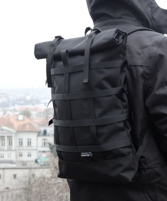 Rolltop black backpack for urban cycling daily commuting and