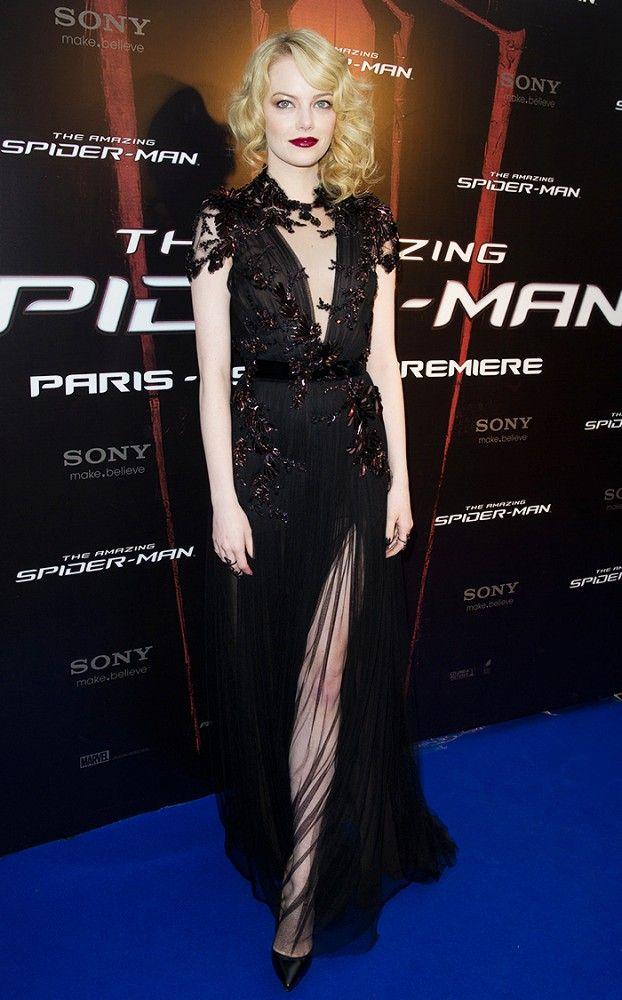 Emma Stone wearing an embellished black sheer Gucci dress and Christian Louboutin heels