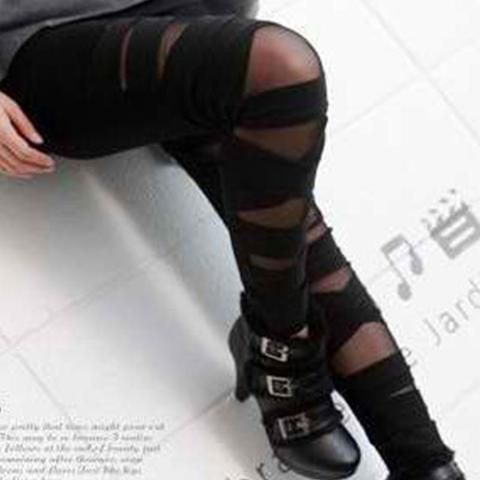 Black Bandage-Wrap Leggings. These are some seriously sexy leggings! The wraps stay put, no more sliding down your thighs. Interior spaces have strong mesh.