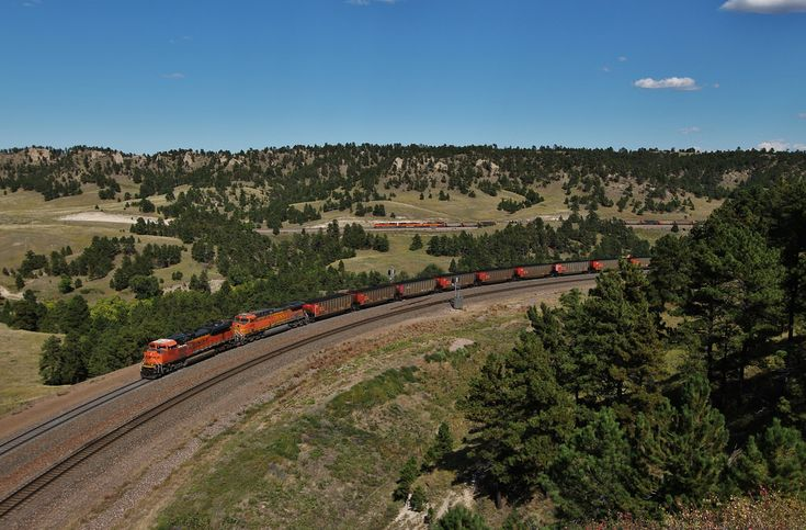The sound of steel and diesel coats the air, and the sound of nearly 20000 horses echos a chorus of pure grit and power on the canyon walls. This is the Crawford Hill Helper district at its core. This BNSF coal train is in the second of two horseshoes coming through the grueling 1.1% grade through the pass. It was a lengthy hike to get to this point, but man it was worth it.