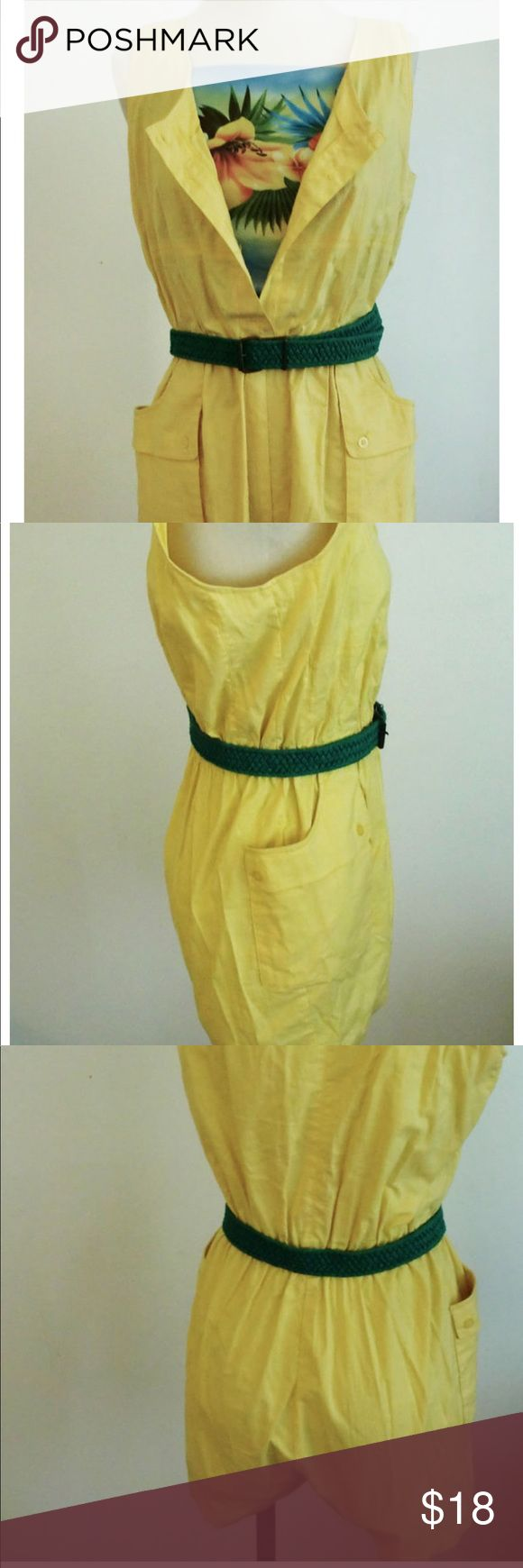 """VINTAGE Canary Yellow Romper Playsuit Beautiful yellow light cotton fabric with an elastic waist, buttons up the front, and side pockets. Bottom portion are shorts.     Cool linen feel of the fabric is perfect for comfort in the hot weather!    Made by Cest Joli.     Tag says size L but check measurements please (laying flat):    Armpit to armpit- 18 1/2""""  Shoulder to bottom hem of shorts- 33""""  Waist (elastic portion)- 14"""" and 19"""" max stretched    *Sorry, belt and Hawaiian undershirt not…"""