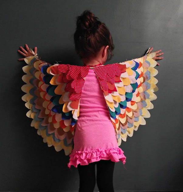 Dress Up Bird Wings  Pattern / Tutorial. I made Noah a pair of owl wings (using white and brown patterned fabric). I'm not sure how she got her feathers in a perfect arch like that. That's the good thing about 2 year old's, he's just psyched he looks like an owl! ;)