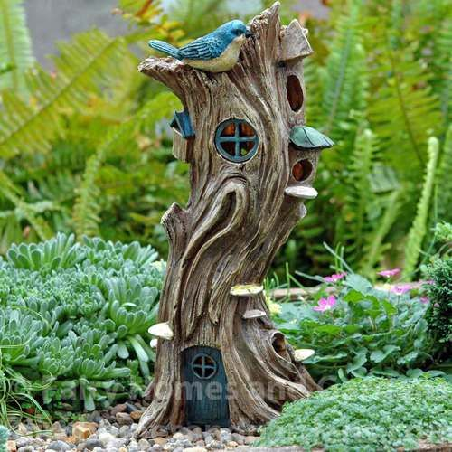 Twisted Trunk Fairy House adorned with fungi, topped with a Bluebird, and solar powered to light up at night.