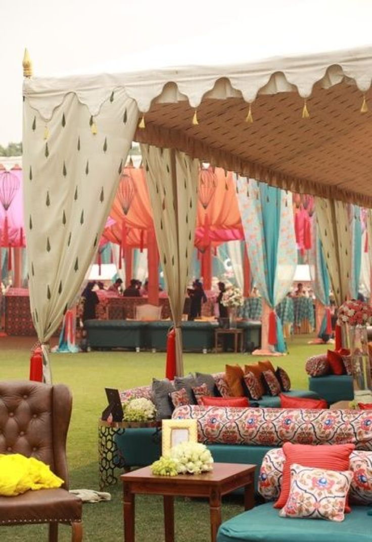 Shamiyana style tent design with multicolored tents and sophisticated sofa sets for the guest to relax on | Outdoor Indian wedding| Quirky Indian Tent Wedding | Credits: wedmegood.com | Every Indian bride's Fav. Wedding E-magazine to read. Here for any marriage advice you need | www.wittyvows.com shares things no one tells brides, covers real weddings, ideas, inspirations, design trends and the right vendors, candid photographers etc.