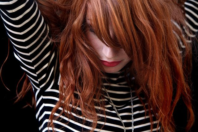 Red hair, stripes, and crimson lipstick. Love it! (by Josephine on flickr)