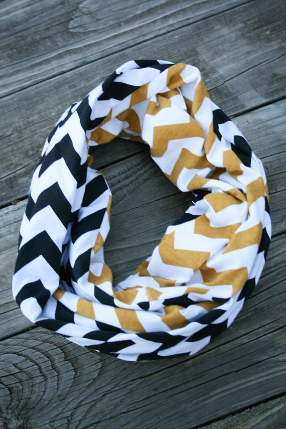 Soft and comfortable infinity scarf in gold and black chevron jersey knit. Perfect for fall or winter - be the best dressed at your next football game!