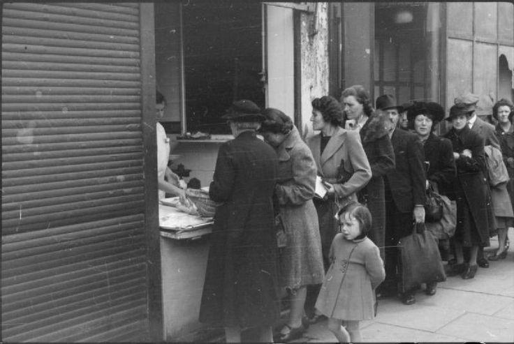 Shoppers queuing for fish in South London, 1945; Not all foods were rationed. Fruit and vegetables were never rationed but were often in short supply, especially tomatoes, onions and fruit from overseas. Supplies were sometimes so limited that some shops operated more like a kiosk, with their entrances shuttered up and just a window open from which the goods were sold. Fish queues were notoriously long.