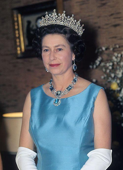 HM Queen Elizabeth II wearing the Girls of Great Britain and Ireland tiara along with the earrings and necklace from the Brazilian aquamarine parure.