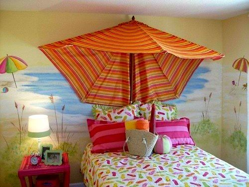 Use a beach unbrella or outdoor umbrella to decorate a beach themed bedroom.