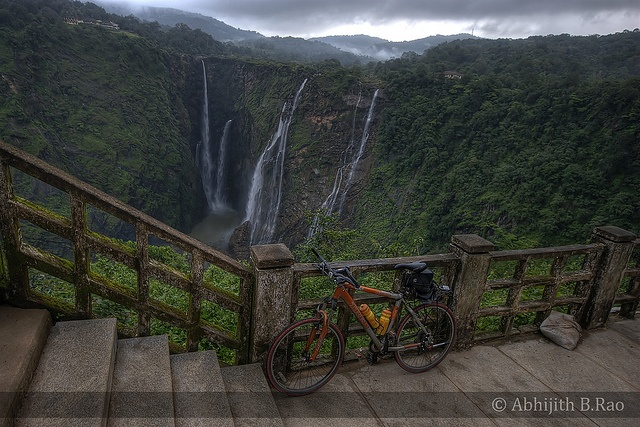 Jog Falls, India, at low water level, showing the viewing platform.  Trek4300 at Misty Jog Falls by Abhijith B.Rao, via Flickr.