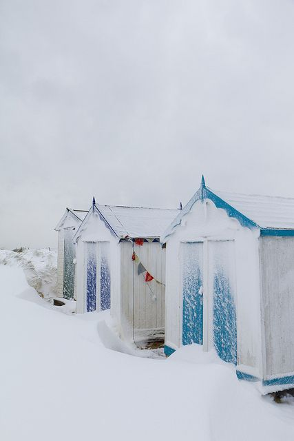 Pristine snow drifts around beach huts, Southwold, via Flickr.