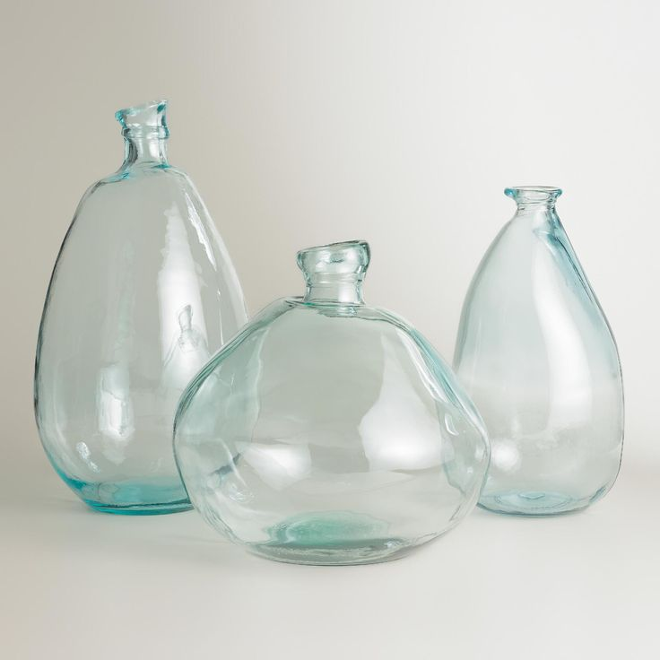 Available in multiple sizes, our recycled glass vases from Spain lend organic style with their subtle texture and unique shape. >> #WorldMarket Living Room Decor, Home Decor, Tips
