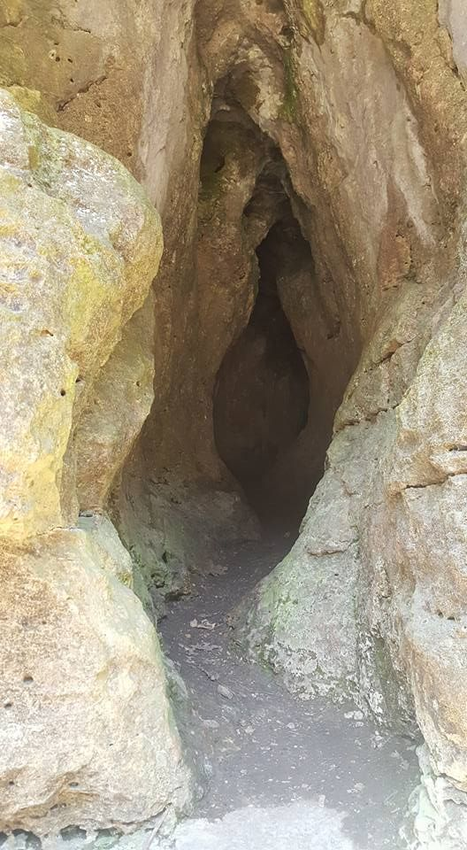 Ice Cave entrance in an Iowa state park. MUST SEE travel destinations in Central East Iowa - collection of places to visit from parks to museums and spooky stops.