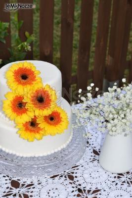 http://www.lemienozze.it/gallerie/torte-nuziali-foto/img27758.html  Torta nuziale con girasoli