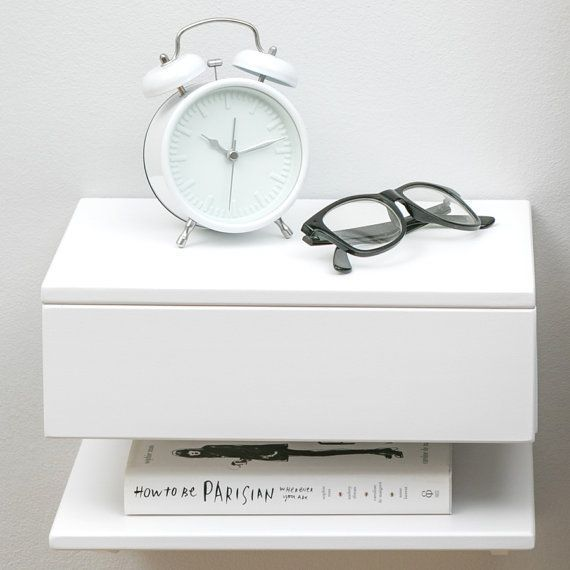 Solid beech bedside table. Attaches to the wall to maximise space use in small bedrooms. One drawer and one shelf. Perfect to fit a lamp, book and clock into a minimal space. Easy to fit to the wall. Available in painted grey, antique white or black. We also have a natural beech version in a different listing. FREE DELIVERY for UK orders  As featured on apartmenttherapy.com:  http://www.apartmenttherapy.com/design-guide-nightstands-perfect-for-small-bedrooms-229886  In stock no...