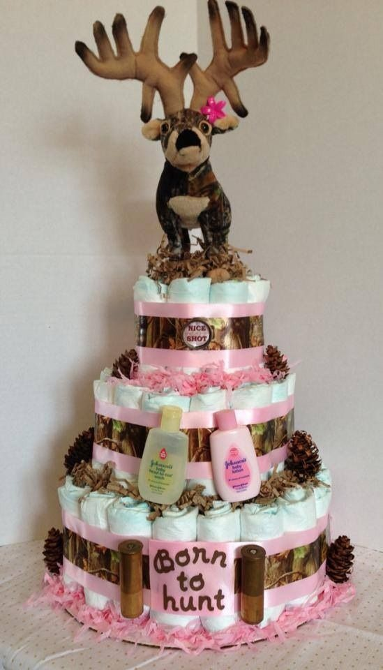 This 3 tier cake is constructed of 72 diapers, camo and light pink ribbons, and plush deer cake topper. This cake is perfect for the outdoorsy parents-to-be would that are expecting a little princess.