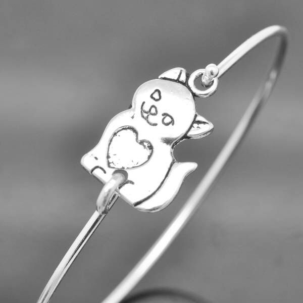 A personal favorite from my Etsy shop https://www.etsy.com/listing/191292469/cat-bangle-sterling-silver-bangle-cat
