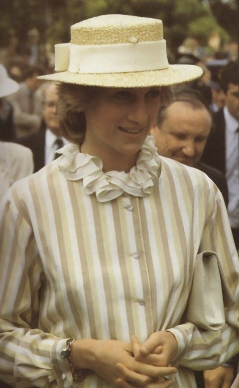Princess Diana is wearing a yellow, coffee & white striped silk suit designed by Arabella Pollen & straw hat by John Boyd while in Adelaide, Australia, March 1983.