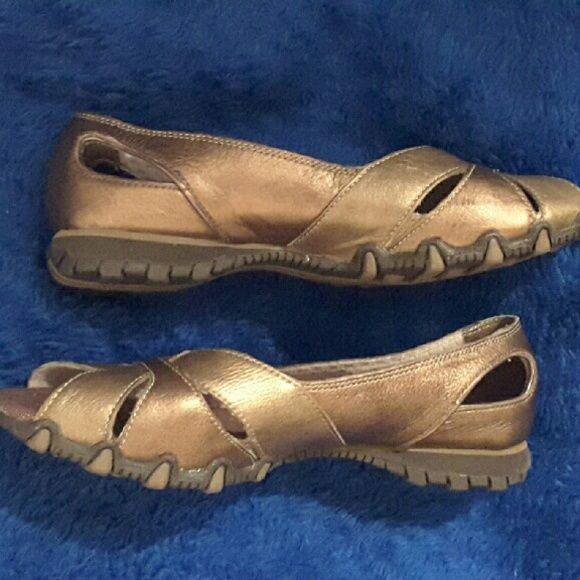 PULSATE LADIES SKECHERS Never worn. Bronze color sketchers. Look gold when flash hits them but color is more like 1st, 3rd, and 4th photos. Original box. Perfect to dress up jeans and to wear to work. Skechers Shoes Sneakers