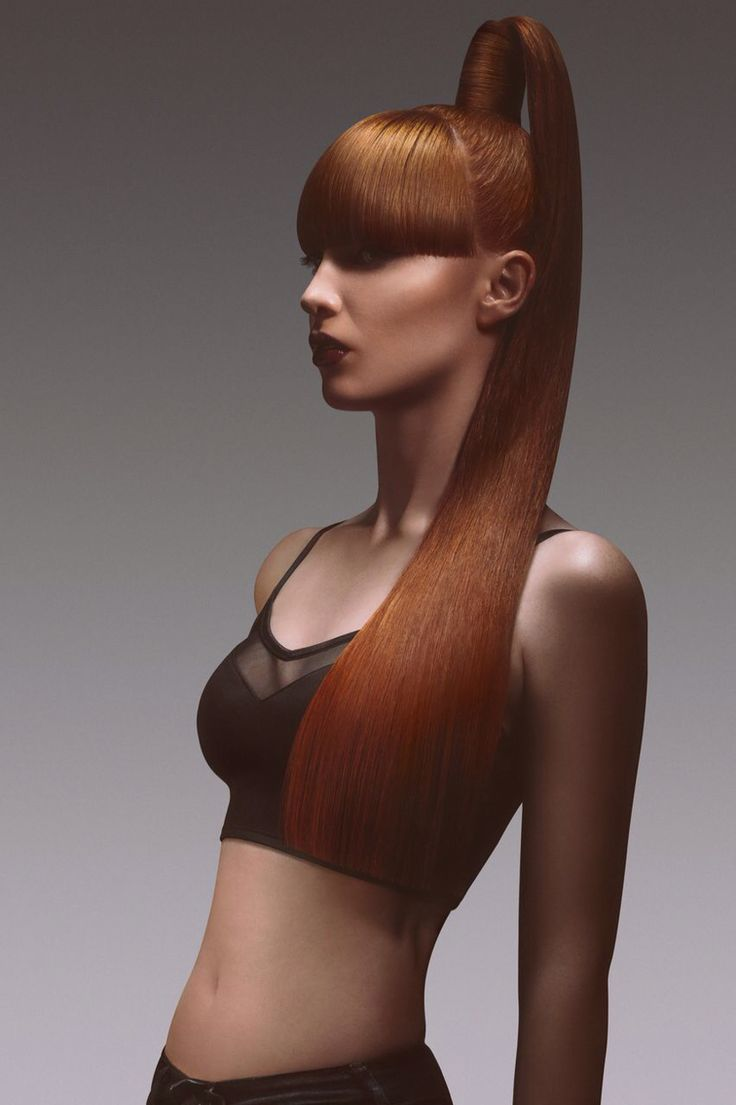 Sharp, long copper hair up, high ponytail