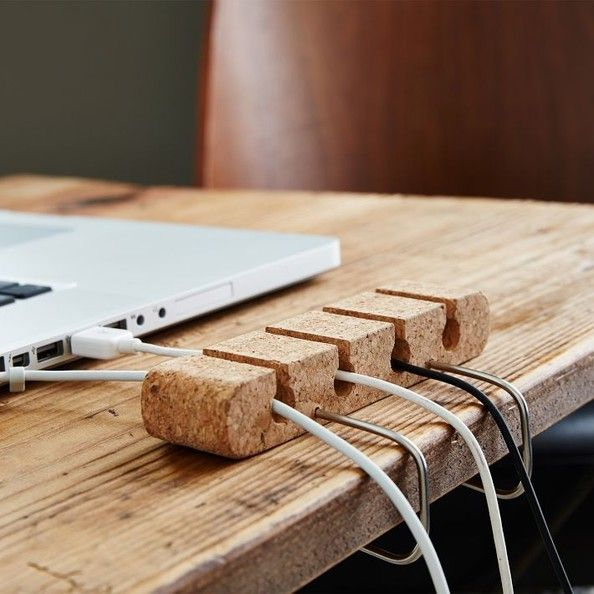 Computer Cable Organizer for $22__Universal Expert Collection by Sebastian Conran__ Everybody needs a little guidance once in a while, especially when it comes to keep cords and cables tidy. This soft cork cable guide should keep the desktop clutter-free without damaging power or USB cables, while also lending a warm dash of color and texture to the workspace.  http://www.lonny.com/20+Tech+Accessories+Under+25/articles/gmHVbCXNNZu/Universal+Expert+Collection+Sebastian+Conran