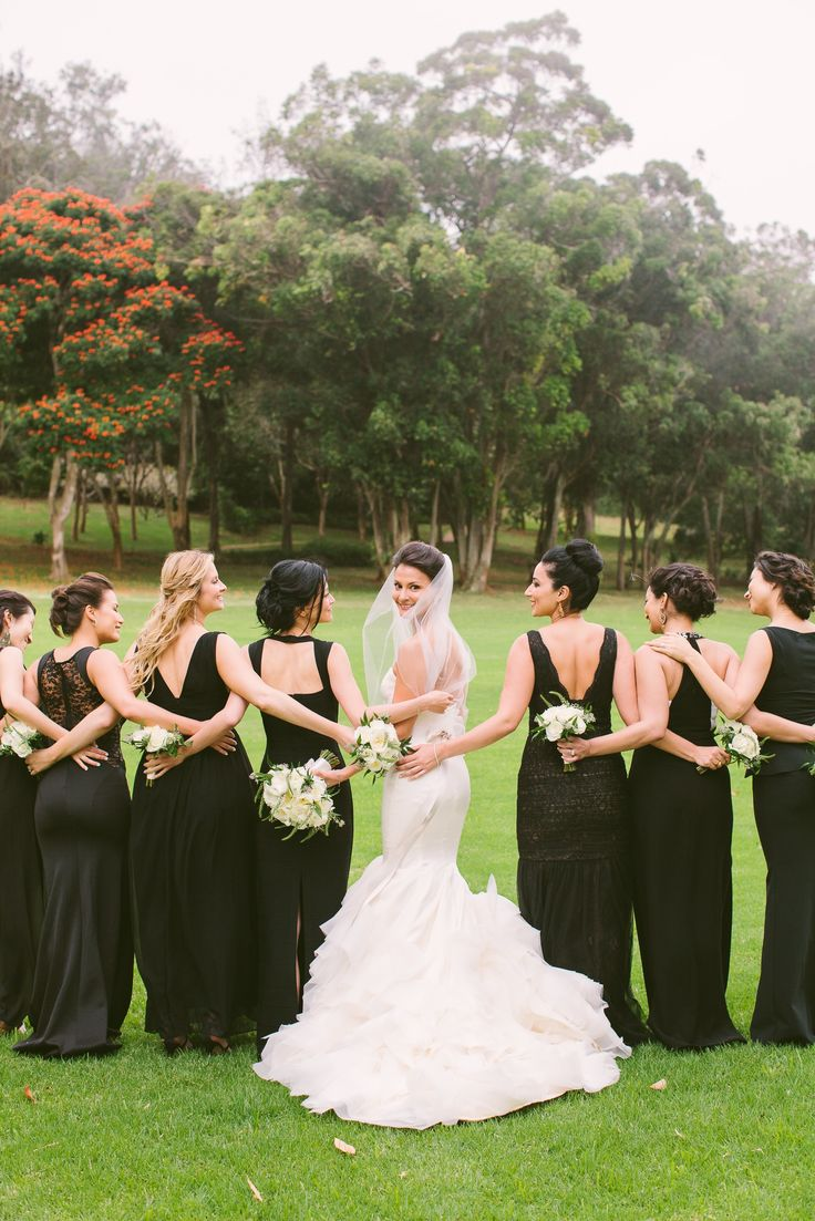 Long, mismatched black bridesmaid dresses | Rebecca Arthurs Photography | theknot.com