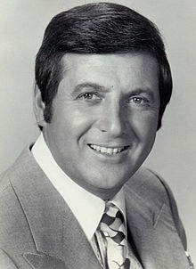 Monty Hall | Monte Halperin, OC, OM (born August 25, 1921), better known by the stage name Monty Hall, is a Canadian-born MC, producer, actor, singer and sportscaster, best known as host of the television game show Let's Make a Deal.