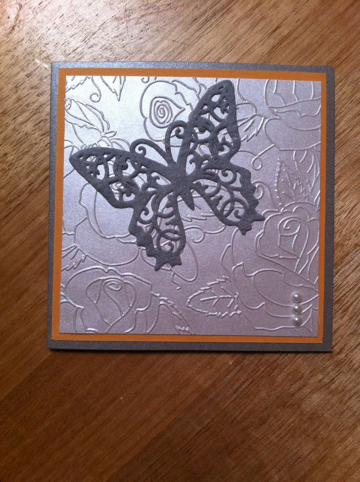 Felt butterfly on a silver embossed card