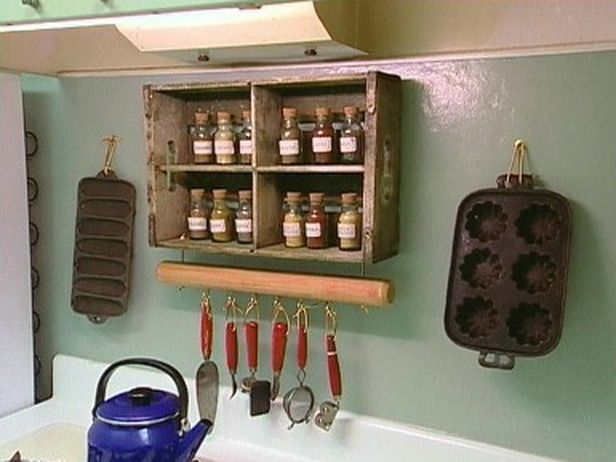 As seen on HGTV, an old wooden crate is repurposed into a lovely, weathered spice rack.