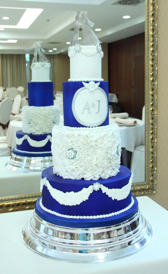 Royal blue and white Wedding Cake by Delicut Cakes - http://cakesdecor.com/cakes/281696-royal-blue-and-white-wedding-cake