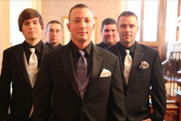 Groom and groomsmen  Possibly groom in all black and steel grey and groomsmen in dark purple.