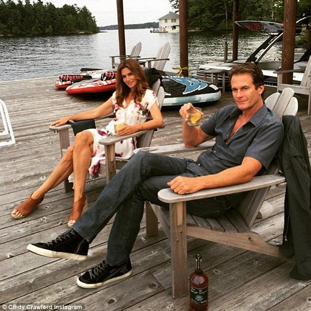 'Docktails': Cindy and her husband Rande Gerber sipped on cocktails while lounging on the ...