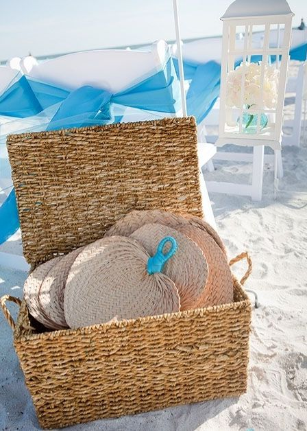 Keep guests cool at your beach wedding with fans.
