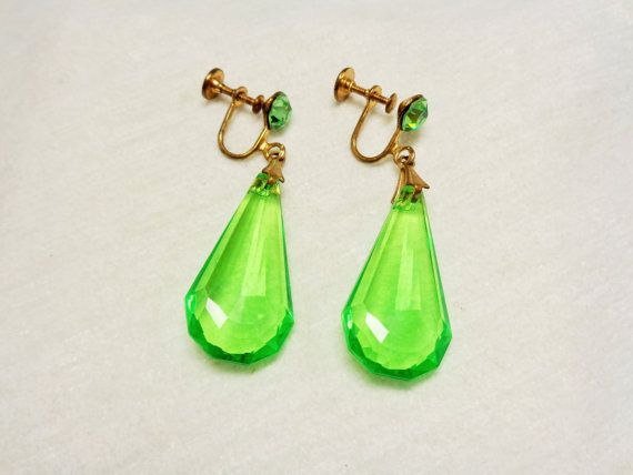 People will see you coming from a mile away when you wear these stunning green earrings.  These earrings are 2 inches in length. The bottom is made of clear facetted acryli...