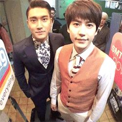 Super Junior's Siwon and Kyuhyun with a rotating camera.