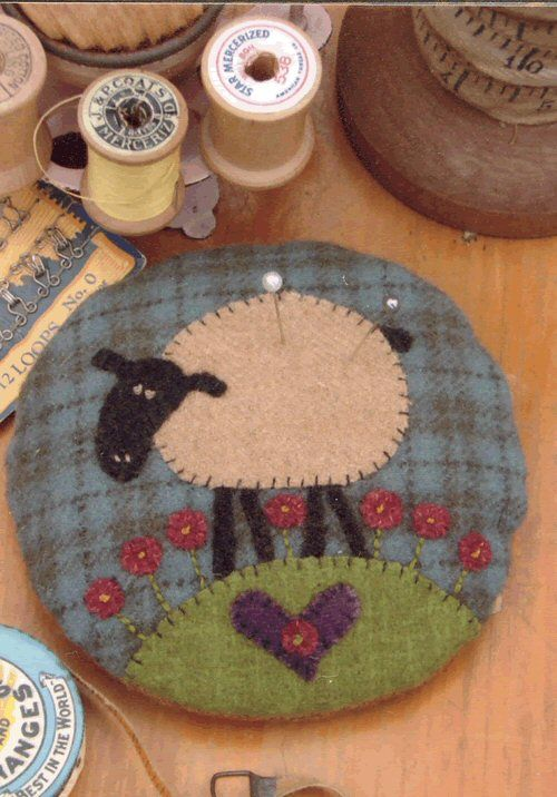 sweet wool applique cushion...pinned for my prim friends
