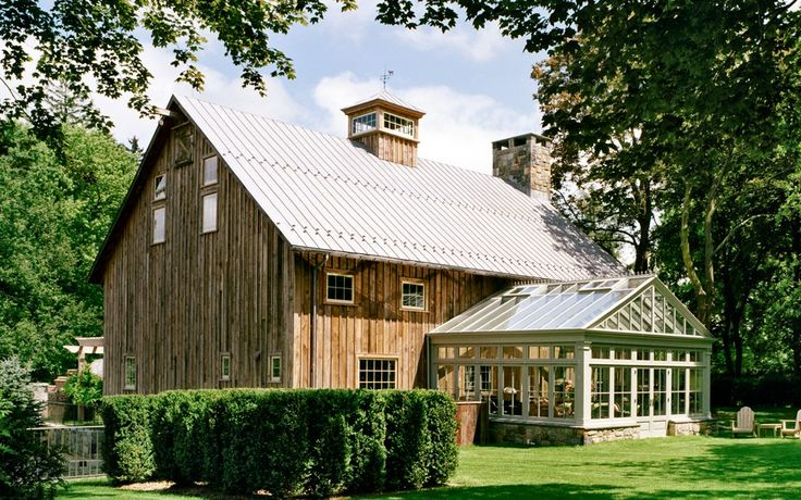 This huge sawn hay barn was built originally circa 1870.  The flooring, ceiling and exterior siding are vintage reclaimed barn boards.  The restored barn is now a guest house, garage and wine cellar for a residential estate in southwestern Connecticut.