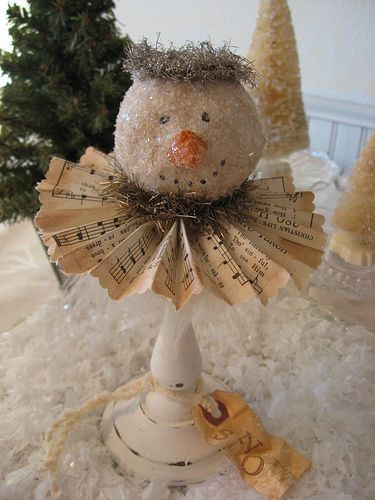 Snowman.  I love this... cute and easy to make!  Candle stick, fold a sheet of your favorite paper and a snowman, deer or santa head!!