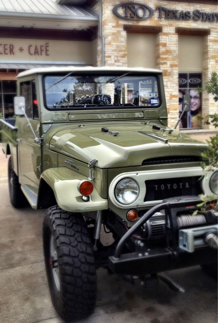 Toyota FJ45, we had one just like this only factory brown. Great 4 wheeler. Once drove 300 in a blizzard through the mountains with out chains. Drove great, everyone else was in the ditch.