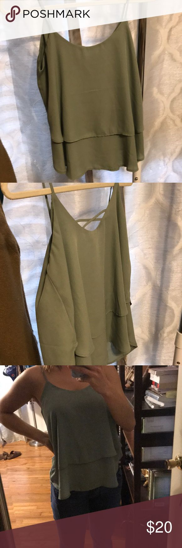 FRANCESCAS flowy sage green strappy top 100% polyester Sage green top So cute! Very comfortable. Fabric falls in two tiers. Mini cross-back detailing. Francesca's Collections Tops Blouses