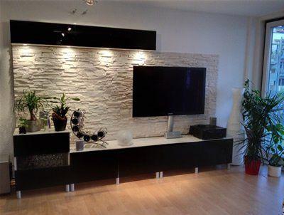 Mobile Tv BESTA con  parete rivestita di mattonelle di roccia